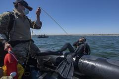 U.S. Navy explosive ordinance disposal technicians train in the Black Sea.