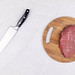 Top view Raw Beef Meat slice on the wooden board with knife