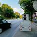 Speeding car passing portable speed control unit on the street