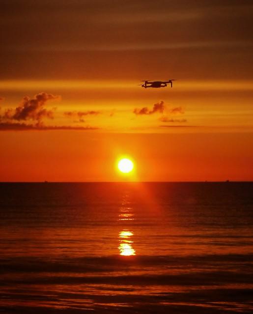 drone dji quadcopter propelled unmanned sunrise sunset landscape seascape scarborough northeast sand beach rocks bunkers cliffs white waves ripple photography photograph mavic mini phantom controller