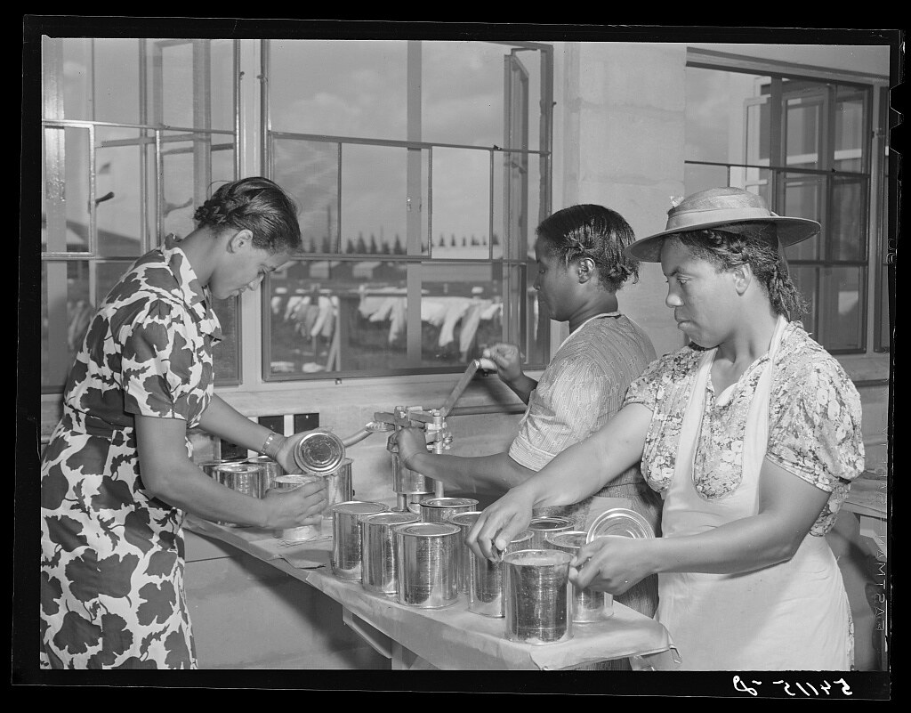 Camp members canning tomatoes in utility building at Okeechobee migratory labor camp. Belle Glade, Florida (LOC)