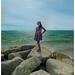 Elsa on beach stones