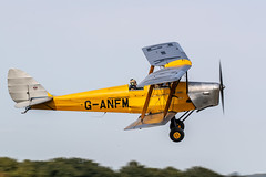 Photo of de Havilland DH82A Tiger Moth getting airborne at Lashenden / Headcorn aerodrome, UK