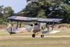 de Havilland DH82A Tiger Moth G-AXXV / DE992 landing at Lashenden / Headcorn aerodrome, UK
