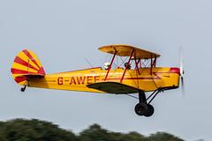 Photo of SNCAN Stampe SV.4C G-AWEF taking off from Lashenden / Headcorn aerodrome, UK