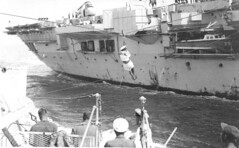 Transferring personnel by Bosun's Chair to HMS Warrior from HMNZS Roititi