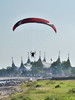 Paragliding along the beach