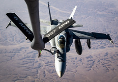 A U.S. Marine Corps F/A-18C Hornet refuels from a U.S. Air Force KC-135 Stratotanker over the U.S. Central Command area of responsibility.