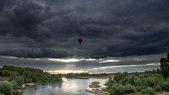 "A hot air balloon over the Loire river • <a style=""font-size:0.8em;"" href=""http://www.flickr.com/photos/125767964@N08/50422233913/"" target=""_blank"">View on Flickr</a>"