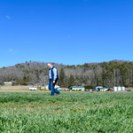 Jason Davis in barley fields at his Mills River farm