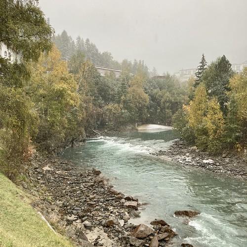 Autumn snow over the river Sölden