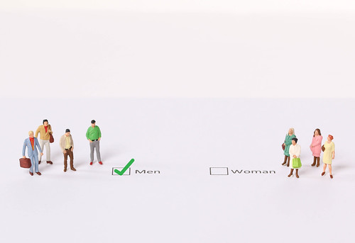 Miniature people standing in front of a check box selected as a MEN