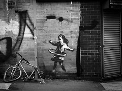 Photo of girl hula-hooping with a bicycle tyre