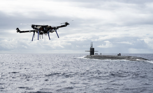 An unmanned aerial vehicle delivers a payload to the Ohio-class ballistic-missile submarine USS Henry M. Jackson (SSBN 730) near the Hawaiian Islands.
