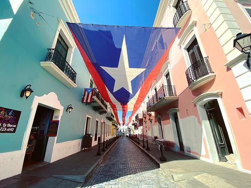 Flag over Fortaleza Street in Old San Juan