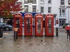 Four red telephone boxes