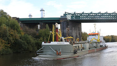 Photo of 20th October 2020.  Sospan Dau and the railway viaduct on the Manchester Ship Canal at Irlam, Salford, Greater Manchester.