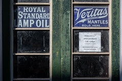 Photo of Vintage advertising on shop door in Stockbridge, Edinburgh, Scotland