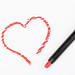 Heart drawn with lipstick on a white background
