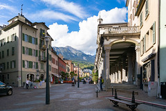 Picturesque view of central street of Sion, Switzerland with epic mountains in the background