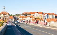 Cars and people on Old bridge in Maribor, Slovenia