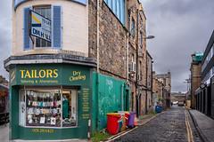 Street with tailor shop in Edinburgh's Stockbridge area, Scotland