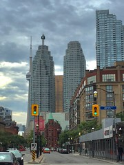 Front Street with CN Tower peeking behind buildings