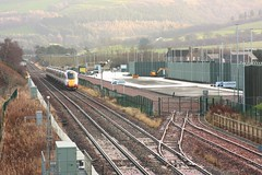 Photo of BLD64-19 LNER Azuma 800104 on the IE13 from Inverness to Peterborough passing the Highland Spring Railfreight Terminal at Blackford