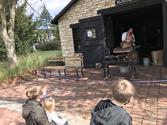 "Watching the Blacksmith at Naper Settlement • <a style=""font-size:0.8em;"" href=""http://www.flickr.com/photos/109120354@N07/50633603228/"" target=""_blank"">View on Flickr</a>"
