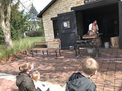 "Watching the Blacksmith at Naper Settlement • <a style=""font-size:0.8em;"" href=""http://www.flickr.com/photos/109120354@N07/50633603808/"" target=""_blank"">View on Flickr</a>"