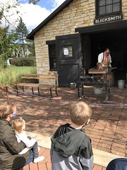 "Watching the Blacksmith at Naper Settlement • <a style=""font-size:0.8em;"" href=""http://www.flickr.com/photos/109120354@N07/50633604953/"" target=""_blank"">View on Flickr</a>"
