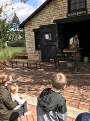 "Watching the Blacksmith at Naper Settlement • <a style=""font-size:0.8em;"" href=""http://www.flickr.com/photos/109120354@N07/50634438842/"" target=""_blank"">View on Flickr</a>"