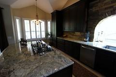 Rustic Traditional #KitchenRemodel with custom dark #cabinets Brick Layer Backsplash, custom farmhouse #sink in Yorba Linda, #OrangeCounty https://www.aplushomeimprovements.com/portfolio_page/yorba_linda_traditional_kitchen_fireplace_design_build103/