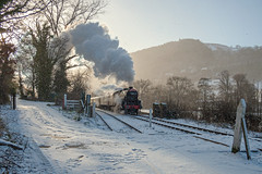 Photo of 44806 passing Pentrefelin works crossing with a Llangollen Railway Santa Special in 2009.