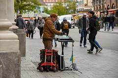 Street musician playing glass harp in Munich