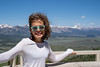 Brunette woman with wavy hair poses at the Galena Summit in the Frank Church Wiilderness of Sawtooth Mountains in Idaho