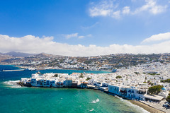 Little Venice with a view of the ferry terminal in Mykonos, Greece