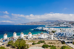 A view of the windmills in Little Venice in Mykonos, Greece as seen from the south