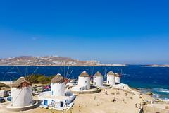 A closer view of the windmills in Little Venice in Mykonos, Greece