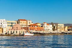 Tour boat anchored near the Mosque Küçük Hasan in Chania, Greece