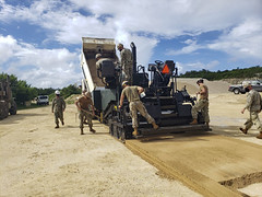Seabees assigned to U.S. Naval Mobile Construction Battalion (NMCB) 3 Detail Tinian execute a sand laydown pave training in preparation for Marpo Heights Road G construction in Tinian.