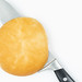 Top view of Knife in the Bread above white background with copy space
