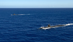 USS Asheville (SSN 758), right, and the French navy submarine FS Émeraude (S604) steam in formation off the coast of Guam.