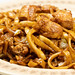 Chinese Food with Spaghetti and Chicken Meat served on the plate