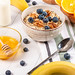 Healthy breakfast background on wooden table with oatmeal, fruit and honey