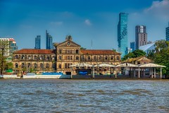 Old and New - Old customs house by the Chao Phraya river with Mahanakhon tower (currently Thailand's tallest building) in Bangkok, Thailand