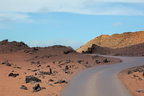 Rural road through the Calderas of Timanfaya National Park