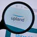 Upland Logo On Screen Under Magnifying Glass