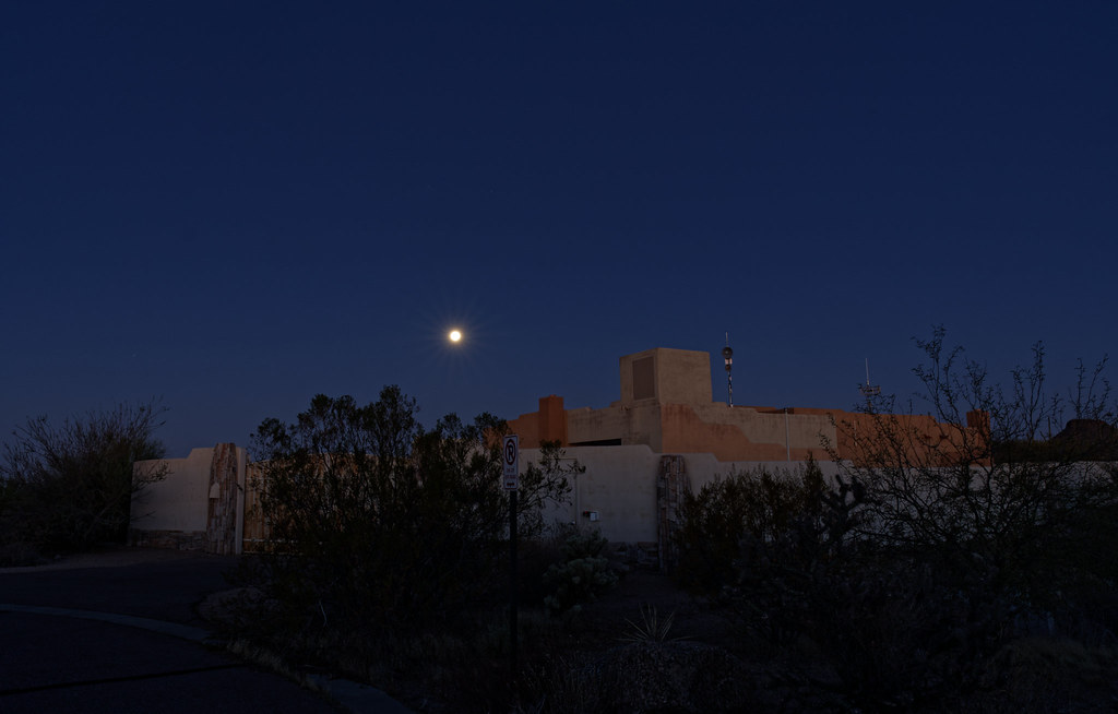 The moon sets over a building near the 114th Street entrance to McDowell Sonoran Preserve in Scottsdale, Arizona on December 30, 2020. Original: _CAM8649.arw