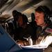 Sailors scan for radar contacts aboard a P-8A maritime patrol aircraft.